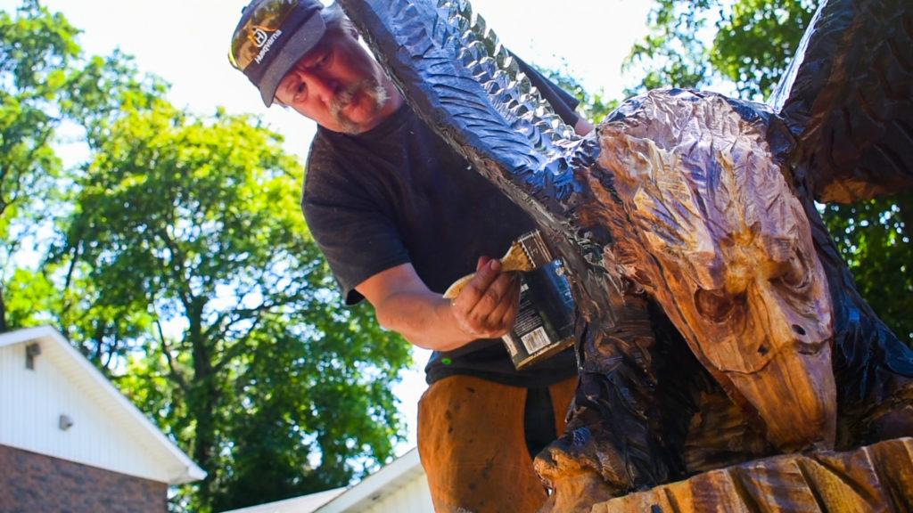 Paul putting sealer on the Bald Eagle
